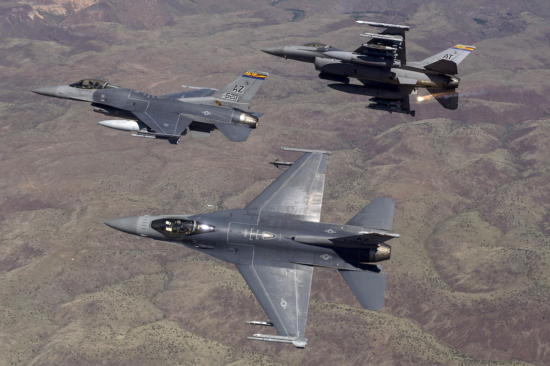F-16 Fighting Falcons from the Arizona Air National Guard's 162nd Wing in Tucson fly over an eastern Arizona training range April 8, 2015. The 162nd Wing conducts international F-16 pilot training and manages a fleet of more than 70 F-16 C/D and Mid-Life Update Fighting Falcons. (U.S. Air Force photo/Master Sgt. Jeffrey Allen)
