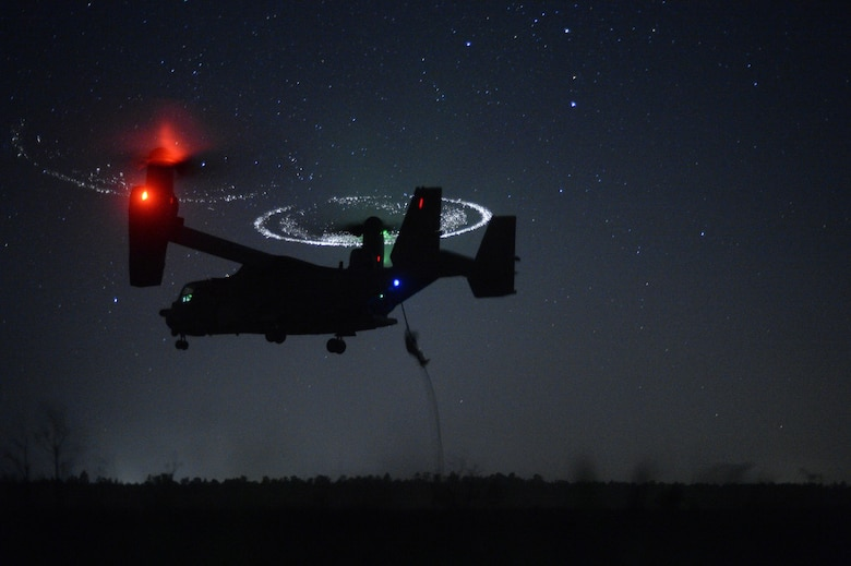 Combat controllers from the 21st Special Tactics Squadron fast-rope from a CV-22 Osprey during Emerald Warrior near Hurlburt Field, Fla., April 21, 2015. Emerald Warrior is the Department of Defense's only irregular warfare exercise, allowing joint and combined partners to train together and prepare for real-world contingency operations. (U.S. Air Force photo/Staff Sgt. Jonathan Snyder)