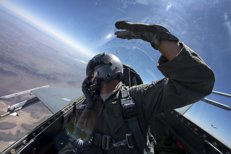 F-16 Fighting Falcons from the Arizona Air National Guard's 162nd Wing fly an air-to-air training mission against student pilots April 8, 2015. The 162nd Wing trains international and U.S. Air Force student pilots to employ the F-16. The 162nd is the largest ANG fighter wing in the country and resides on 94 acres next to the Tucson International Airport. (U.S. Air Force photo/Master Sgt. Jeffrey Allen)
