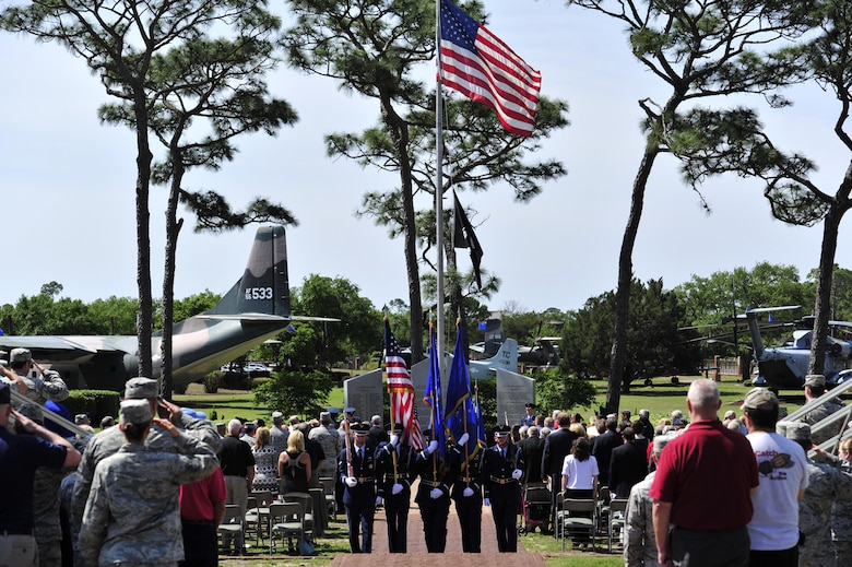 The honor guard departs the Operation Eagle Claw memorial ceremony after presenting the colors at the air park on Hurlburt Field, Fla., April 24, 2015. Operation Eagle Claw, conducted April 24, 1980, was a joint services mission to rescue Americans who were being held hostage by a mob in Tehran, Iran, since Nov. 4, 1979. Tragically, the attempt ended in the death of eight service members. (U.S. Air Force photo/Staff Sgt. Melanie Holochwost)