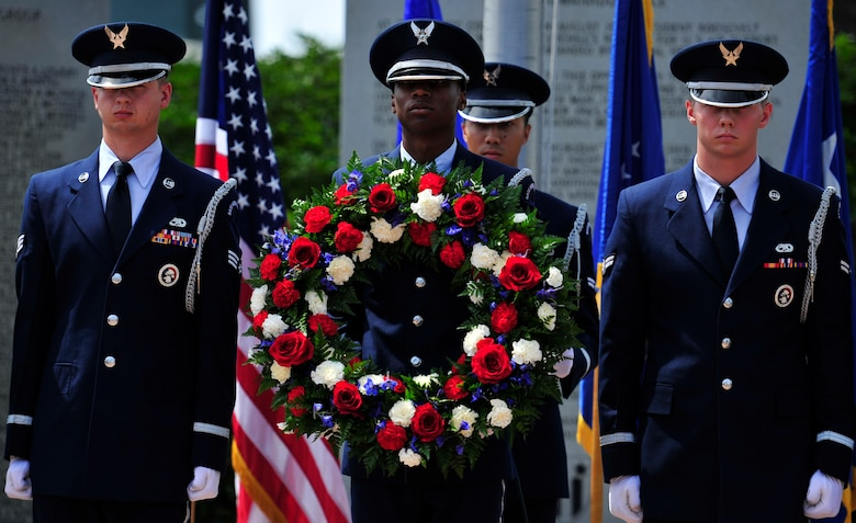The honor guard presents a wreath during the Operation Eagle Claw memorial ceremony at the air park on Hurlburt Field, Fla., April 24, 2015.  The rose wreath was placed in honor of the eight service members who lost their lives during the operation. (U.S. Air Force photo/Staff Sgt. Melanie Holochwost)
