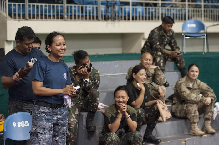 Philippine Coast Guard Lt. j.g. Melisa M. Acosta, Political Service nurse officer and assistant team leader, provides feedback for local health workers during exercise Balikatan's first responder training course in Puerto Princesa, Palawan, Philippines, April 22. U.S. military and Armed Forces of the Philippines training instructors worked shoulder-to-shoulder to train 179 health workers and members of other local agencies to learn skills and techniques to better respond to a mass casualty. This year marks the 31st iteration of the exercise, which is an annual Philippine-U.S. bilateral military training exercise and humanitarian civic assistance engagement.