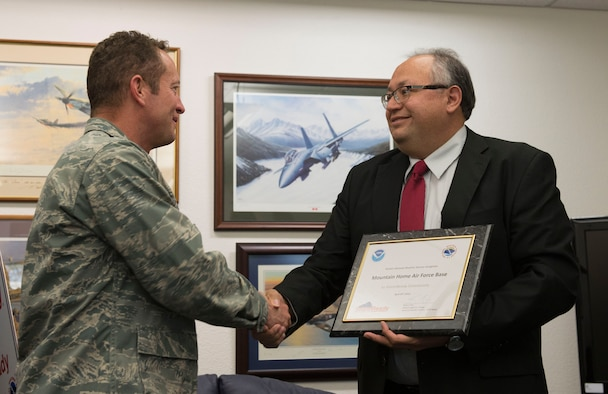 Robert Diaz Jr. (right), National Weather Service meteorologist in charge, presents Col. David Iverson, 366th Fighter Wing commander, with a certificate at Mountain Home Air Force Base, Idaho, April 23, 2015. StormReady communities are better prepared to react to severe weather. (U.S. Air Force photo by Airman 1st Class Jeremy L. Mosier/Released)