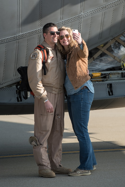 Capt. Brice Hayden, a C-130 navigator in the Georgia Air National Guard's 165th Airlift Wing, and his wife, Kristin Hayden, take a selfie at the Kentucky Air National Guard Base in Louisville, Ky., April 24, 2015, prior to his deployment to an undisclosed air base in the Persian Gulf region. Hayden's unit has joined forces with the Kentucky Air Guard's 123rd Airlift Wing to flying airlift missions throughout the U.S. Central Command Area of Responsibility in support of Operation Freedom's Sentinel, which provides military training and counterterrorism capabilities in Afghanistan. (U.S. Air National Guard photo by Maj. Dale Greer)