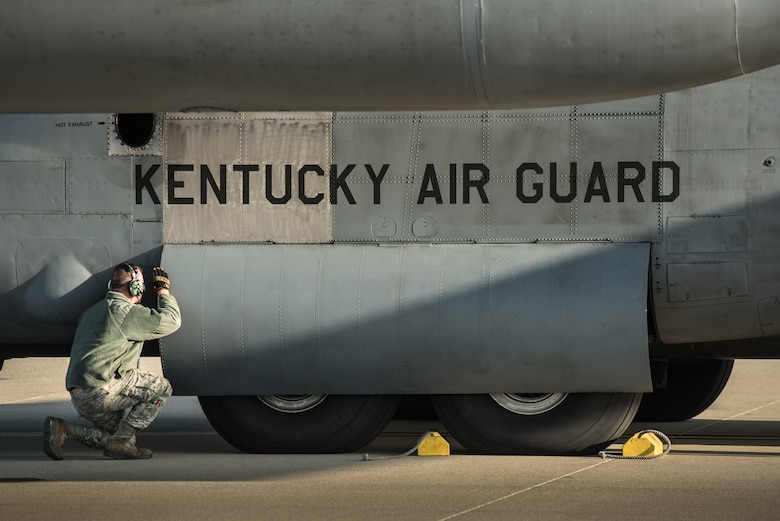 Airman 1st Class Jacob Reynolds, a crew chief in the 123rd Aircraft Maintenance Squadron, inspects a C-130 Hercules aircraft at the Kentucky Air National Guard Base in Louisville, Ky., April 24, 2015. The aircraft and more than 40 members of the 123rd Airlift Wing are deploying to an undisclosed air base in the Persian Gulf region, where they will fly airlift missions in support of Operation Freedom's Sentinel. (U.S. Air National Guard photo by Maj. Dale Greer)