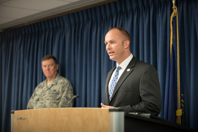Matt Selph, director of the Kentucky Board of Elections, speaks to more than 40 members of the 123rd Airlift Wing at the Kentucky Air National Guard Base in Louisville, Ky., April 24, 2015, prior to the Airmen's deployment to an undisclosed air base in the Persian Gulf region. The troops, who left aboard a Kentucky Air Guard C-130 Hercules aircraft, comprise the third rotation of 123rd Airmen to deploy to the base since February. The Air Guardsmen will be flying airlift missions throughout the U.S. Central Command Area of Responsibility in support of Operation Freedom's Sentinel, which provides military training and counterterrorism capabilities in Afghanistan. (U.S. Air National Guard photo by Maj. Dale Greer)