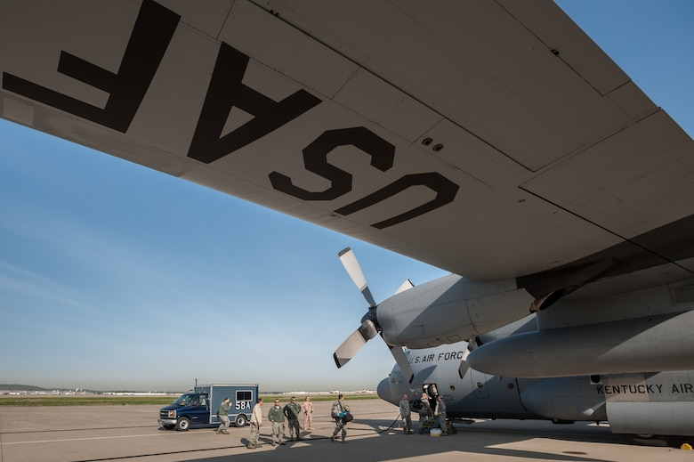 Airmen from the 123rd Airlift Wing board a C-130 Hercules aircraft at the Kentucky Air National Guard Base in Louisville, Ky., April 24, 2015, prior to their departure for deployment to an undisclosed air base in the Persian Gulf region. The Air Guardsmen will be flying airlift missions throughout the U.S. Central Command Area of Responsibility in support of Operation Freedom's Sentinel, which provides military training and counterterrorism capabilities in Afghanistan. (U.S. Air National Guard photo by Maj. Dale Greer)