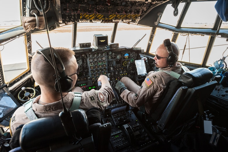 Capt. Nick Reinke (left) and Capt. Josh Ketterer, C-130 pilots in the 123rd Airlift Wing, conduct preflight checklists at the Kentucky Air National Guard Base in Louisville, Ky., April 24, 2015, prior to their departure to an undisclosed air base in the Persian Gulf region. More than 40 other Kentucky Air National Guardsmen were also on board the aircraft. While deployed, the Airmen will fly airlift missions in support of Operation Freedom's Sentinel. (U.S. Air National Guard photo by Maj. Dale Greer)
