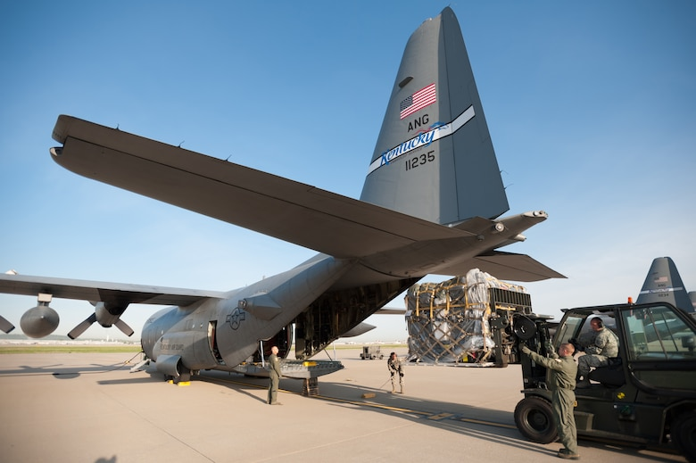 Loadmasters and cargo specialists from the 123rd Airlift Wing load cargo onto a C-130 Hercules aircraft at the Kentucky Air National Guard Base in Louisville, Ky., April 24, 2015, prior to the aircraft's departure for deployment to an undisclosed air base in the Persian Gulf region. More than 40 Kentucky Air National Guardsmen boarded the plane. They will join other Airmen already in theater to fly airlift missions in support of Operation Freedom's Sentinel. (U.S. Air National Guard photo by Maj. Dale Greer)