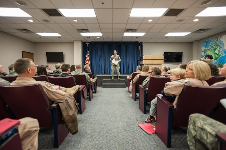 More than 40 members of the 123rd Airlift Wing attend a pre-departure brief at the Kentucky Air National Guard Base in Louisville, Ky., April 24, 2015, prior to deploying to an undisclosed air base in the Persian Gulf region. The Airmen, who left aboard a Kentucky Air Guard C-130 Hercules aircraft, comprise the third rotation of 123rd Airmen to deploy to the base since February. The Air Guardsmen will be flying airlift missions throughout the U.S. Central Command Area of Responsibility in support of Operation Freedom's Sentinel, which provides military training and counterterrorism capabilities in Afghanistan. (U.S. Air National Guard photo by Maj. Dale Greer)