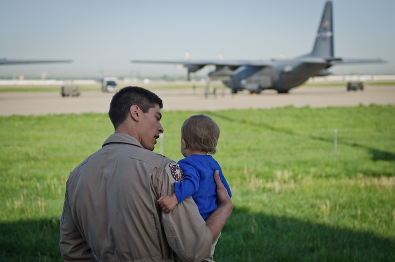 Capt. Trevor Sutherland, a C-130 pilot in the 123rd Airlift Wing, talks to his son at the Kentucky Air National Guard Base in Louisville, Ky., April 24, 2015, prior to departing for a deployment to the Persian Gulf. Sutherland was among more than 40 Kentucky Air National Guardsmen who deployed to an undisclosed air base in support of Operation Freedom's Sentinel. (U.S. Air National Guard photo by Master Sgt. Phil Speck)