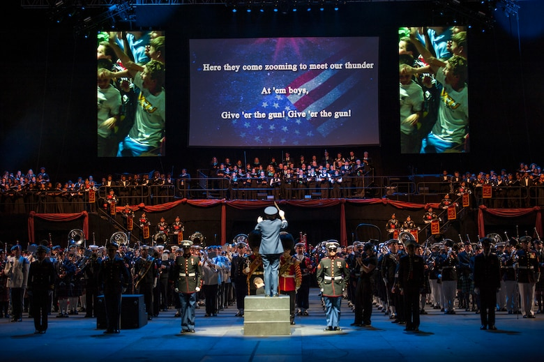 """A United States Air Force Master Sergeant conducts the 2015 Virginia International Tattoo during a presentation of the Air Force song, February 23. The Tattoo is an annual performance exhibiting military bands, massed pipes and drums, drill teams, Celtic dancers, cultural performers, choirs and more. This year's theme is """"A Tribute to Military Families."""" (U.S. Air Force photo by Staff Sgt. Steve Stanley/Released)"""