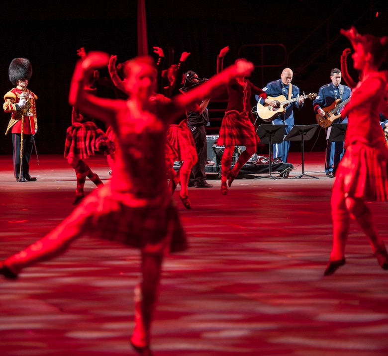 """Members of the USAF Heritage of America Band perform in the 2015 Virginia International Tattoo at the Norfolk Scope Arena on February 23. The Tattoo is an annual performance exhibiting military bands, massed pipes and drums, drill teams, Celtic dancers, cultural performers, choirs and more. This year's theme is """"A Tribute to Military Families."""" (U.S. Air Force photo by Staff Sgt. Steve Stanley/Released)"""
