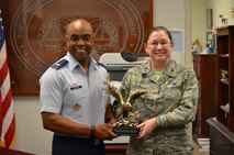 Col. Edwards celebrates with Col. Elizabeth Schuchs-Gopaul, Staff Judge Advocate for the 502nd Installation Support Group and 37th Training Wing, for winning the AETC Large Legal Office of the Year 2014.