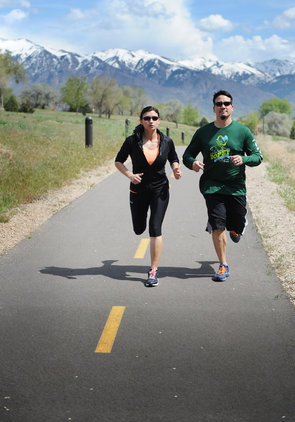 Wounded Air Force combat veteran, Mary Barnett, a program manager with the Air Force Lifecycle Management Center here, runs around the Hill AFB duck pond trail with her husband and running partner David. Mary runs marathons despite having a heart condition from a mortar blast in Iraq. She doesn't let the pacemaker she has to wear restrict her freedom. (U.S. Air Force/Micah Garbarino)