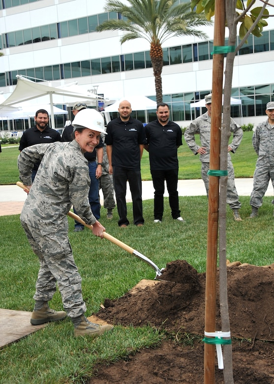 Air Force Colonel Donna Turner, commander of the 61st Air Base Group, at Los Angeles Air Force Base and members of the 61st Civil Engineering and Logistics Squadron participate in a tree-planting ceremony to kick off the Earth Day celebration on April 21, (U.S. Air Force photo by Sarah Corrice)