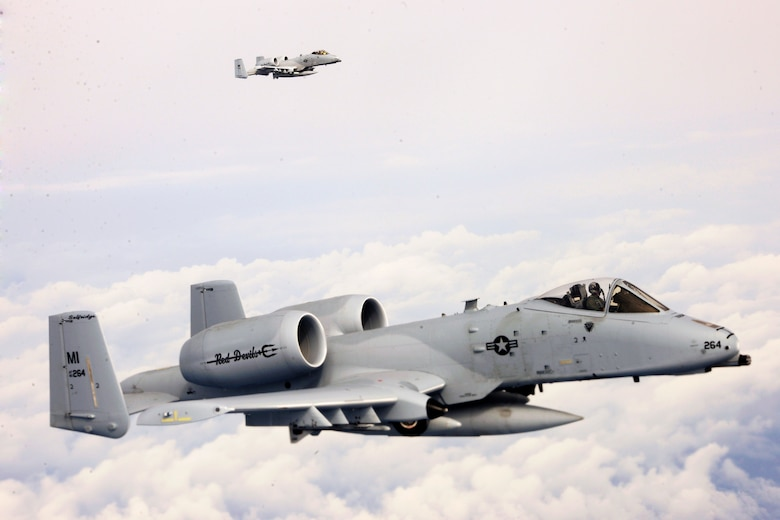 150411-Z-EZ686-983 -- Two A-10 Thunderbolt II's of the 107th Fighter Squadron from Selfridge Air National Guard Base Mich., fly toward Southwest Asia in a deployment of some 350 Michigan Air National Guard Airmen from the base. The Michigan Airmen will be supporting U.S. Central Command operations in the region. (U.S. Air National Guard photo by MSgt. David Kujawa/Released)