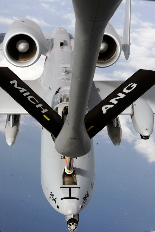 150411-Z-EZ686-671 -- An A-10 Thunderbolt II of the 107th Fighter Squadron from Selfridge Air National Guard Base Mich.,  hooks up for a refueling to a KC-135 Stratotanker of the 171st Aircraft Refueling Squadron during a deployment to Southwest Asia, April 11, 2015. Both squadrons are components of the Michigan Air National Guard. (U.S. Air National Guard photo by MSgt. David Kujawa/Released)