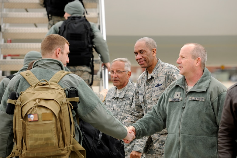 150410-Z-EZ686-027 -- Senior leaders of the Michigan National Guard shake hands with deploying members of the 127th Wing at Selfridge Air National Guard Base, Mich., April 10, 2015. Sending off the Airmen are Major Gen. Gregory J. Vadnais, adjutant general of Michigan; Brig. Gen. Leonard W. Isabelle Jr., commander of the Michigan Air National Guard; and Brig. Gen. John D. Slocum, commander of the 127th Wing. (U.S. Air National Guard photo by Master Sgt. David Kujawa)