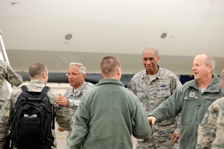150410-Z-EZ686-007 -- Senior leaders of the Michigan National Guard shake hands with deploying members of the 127th Wing at Selfridge Air National Guard Base, Mich., April 10, 2015. Sending off the Airmen are Major Gen. Gregory J. Vadnais, adjutant general of Michigan; Brig. Gen. Leonard W. Isabelle Jr., commander of the Michigan Air National Guard; and Brig. Gen. John D. Slocum, commander of the 127th Wing. (U.S. Air National Guard photo by Master Sgt. David Kujawa)