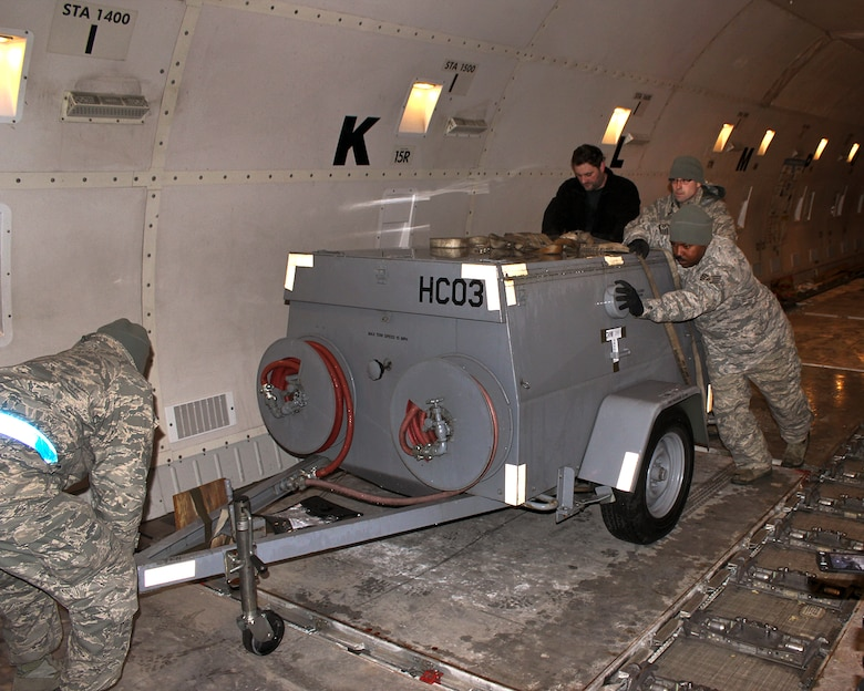 150408-Z-VA676-007 -- Airmen from the 127th Logistics Readiness Squadron and supporting units, prepare and load cargo to support a major deployment of personnel and aircraft from the 127th Wing at Selfridge Air National Guard Base, Mich. The deployment to the U.S. Central Command Area of Responsibility took place in early April 2015. Because of the flight schedules, much of the loading had to take place in the middle of the night. (U.S. Air National Guard photo by Tech. Sgt. Dan Heaton)
