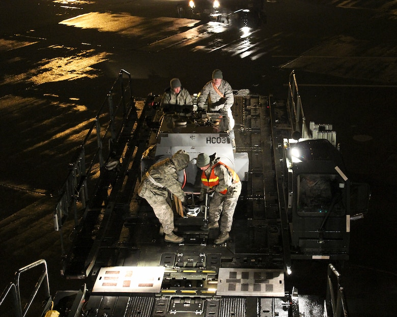 150408-Z-VA676-025 -- Airmen from the 127th Logistics Readiness Squadron and supporting units, prepare and load cargo to support a major deployment of personnel and aircraft from the 127th Wing at Selfridge Air National Guard Base, Mich. The deployment to the U.S. Central Command Area of Responsibility took place in early April 2015. Because of the flight schedules, much of the loading had to take place in the middle of the night. (U.S. Air National Guard photo by Tech. Sgt. Dan Heaton)