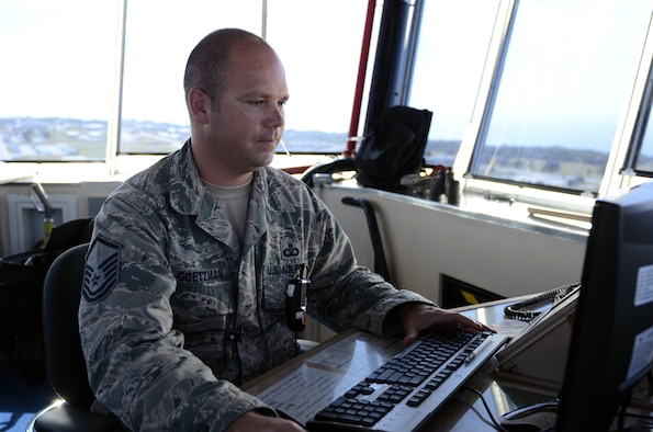 Master Sgt. Shelby Goetzman, 36th Operations Support Squadron chief controller, logs in mission information on Andersen Air Force Base, Guam, April 23, 2015. Andersen air traffic controllers work with deployed aircraft and occasionally foreign aircraft to support Andersen's mission on a daily basis. (U.S. Air Force photo by Airman 1st Class Alexa Ann Henderson/Released)