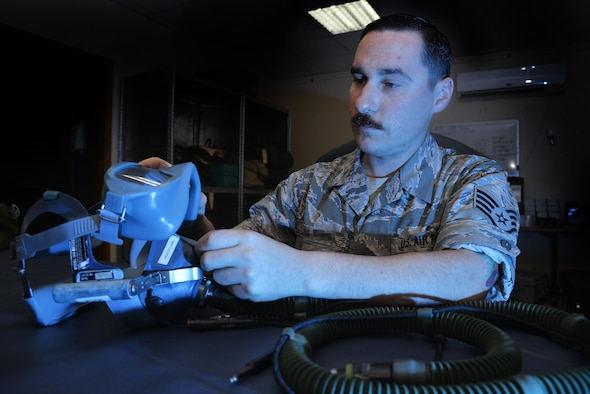 Staff Sgt. Scott performs an inspection of a quick-don mask at an undisclosed location in Southwest Asia April 15, 2015. The inspection ensured the mask was free of tears, holes, debris. Scott is an aircrew flight equipment technician assigned to the Expeditionary Operations Support Squadron. (U.S. Air Force photo/Tech. Sgt. Christopher Boitz)