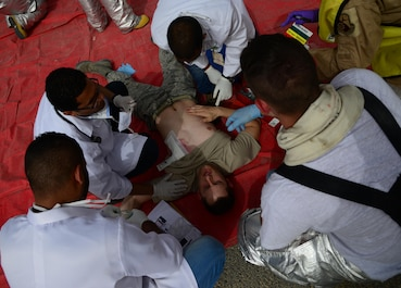U.S. and Qatari first responders triage patients during a Major Accident Response Exercise, April 22, 2015, at Al Udeid Air Base, Qatar. The MARE showcased how host nation and U.S. military work together in an emergency response event. The MARE, which is a mission assurance exercise is required by all Department of Defense Bases on an annual cycle, ensures that personnel are properly trained and proficient at responding to incidents or threats in the event of a real world occurrence. (U.S. Air Force photo by Senior Airman Kia Atkins)