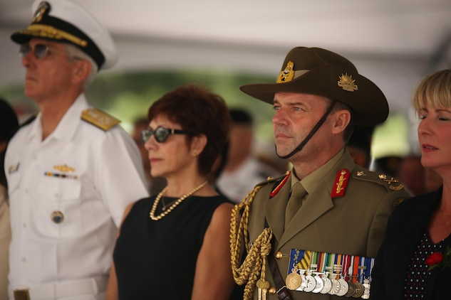 "Australian Army Maj. Gen. Greg Bilton, deputy commanding general of operations with U.S. Army Pacific (right), stands among other attendees during the ANZAC Day Ceremony April 25, 2015, at the National Memorial Cemetery of the Pacific. The day commemorated the 100th anniversary of the Gallipoli Campaign, fought by Australian-New Zealand Army Corps forces in World War I. The battle is remembered for the valiant men and the significant losses the nations both suffered. Those who fought are known as ""ANZACS"" and are honored in one of the most recognized holidays in the South Pacific."