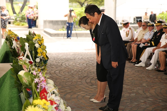 "Toyoei Shigeeda, Consul-General of Japan, bows after laying a wreath during the ANZAC Day Ceremony April 25, 2015, at the National Memorial Cemetery of the Pacific. The day commemorated the 100th anniversary of the Gallipoli Campaign, fought by Australian-New Zealand Army Corps forces in World War I. The battle is remembered for the valiant men and the significant losses the nations both suffered. Those who fought are known as ""ANZACS"" and are honored in one of the most recognized holidays in the South Pacific."