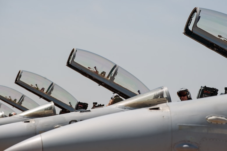 F/A-18 Hornet pilots from Marine Fighter Attack Squadron 225 start up their jets for a sortie during Exercise Max Thunder 15-1 at Gwangju Air Base, Republic of Korea, April 16, 2015. Max Thunder is a regularly scheduled training exercise designed to enhance readiness of U.S. and ROK air forces to defend the ROK. (U.S. Air Force photo by Senior Airman Taylor Curry/Released)