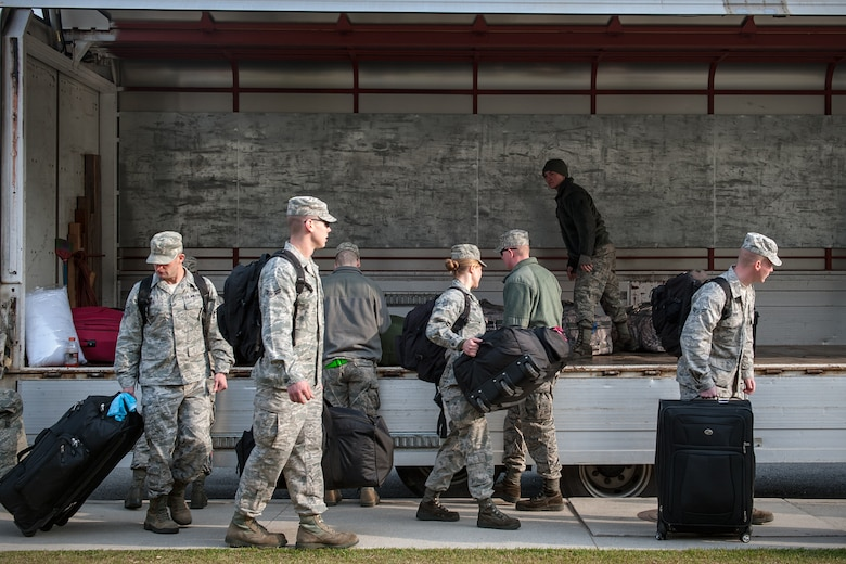 8th Fighter Wing Airmen load luggage into a truck after receiving a deployment briefing at Kunsan Air Base, Republic of Korea, April 10, 2015. Approximately 170 Wolf Pack personnel departed for Gwangju Air Base,ROK, to participate in Exercise Max Thunder 15-1, the largest flying exercise held on the Korean Peninsula. (U.S. Air Force photo by Senior Airman Taylor Curry/Released)