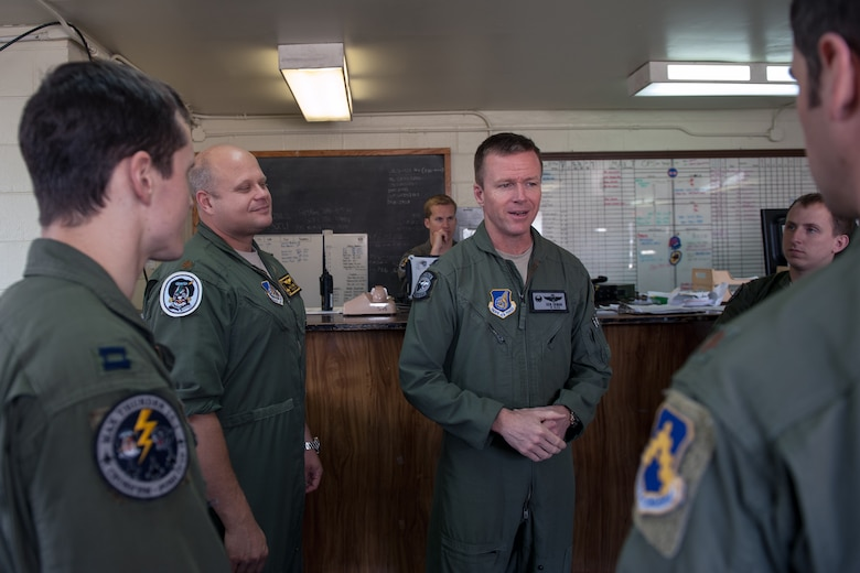 """Col. Ken """"Wolf"""" Ekman, 8th Fighter Wing commander, speaks to pilots after a flight brief during Exercise Max Thunder 15-1 at Gwangju Air Base, Republic of Korea, April 21, 2015. The Wolf Pack joined other U.S. Air Force, Marine Corps and ROKAF flying units to integrate with dissimilar aircraft and practice realistic combat scenarios as one large force. (U.S. Air Force photo by Senior Airman Taylor Curry/Released)"""