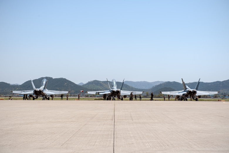 U.S. Marine Corps pilots from Marine Fighter Attack Squadron 225, currently deployed to Marine Corps Air Station Iwakuni, Japan, conduct pre-flight inspections of their F/A-18 Hornets during Exercise Max Thunder 15-1 at Gwangju Air Base, Republic of Korea, April 17, 2015. Max Thunder is a large-scale employment exercise designed to increase U.S. and ROK interoperability and ultimately enhance commitments to maintain peace in the region. (U.S. Air Force photo by Senior Airman Taylor Curry/Released)