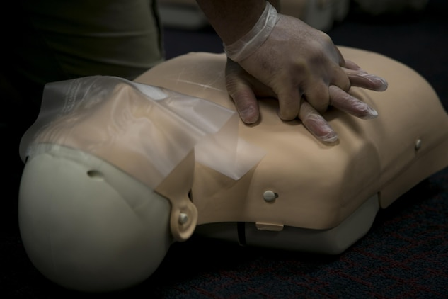 A mannequin receives CPR during a class certifying Marines and Master Labor Contractors in adult, child and infant CPR, use of an automated external defibrillator and basic first aid in the Education Center April 22 on Camp Foster, Okinawa. Each student earned a one year certification in CPR, AED and basic first aid. The class was facilitated by Allen Balabis and Carl Hinson, certified instructors with The American Red Cross. Balabis is the regional director of emergency management of Marine Corps Installations Pacific-Camp Butler, Japan. Hinson is the emergency management analyst for MCIPAC.