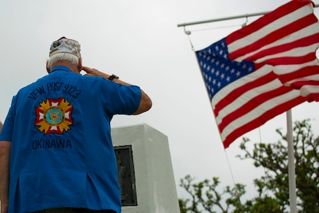 """Dennis E. Provencher, the district commander of Veterans of Foreign Wars Post 9723, Okinawa salutes the Ernie Pyle Monument April 19, after placing a floral wreath at the foot of the epitaph on Ieshima, Okinawa, Japan. Okinawa citizens, service members, veterans, Boy Scouts, and families gather to honor the 70th anniversary of Ernest T. """"Ernie"""" Pyle's death at the sight where he was killed in 1945 during the battle of Okinawa. Pyle was a Pulitzer Prize winner and served as a war correspondent from 1935 through most of World War II, famous for his columns for the Scripps-Howard newspaper chain. Pyle volunteered to deploy with the men of the Army's 77th Infantry Division to report first-hand during the battle of Okinawa."""