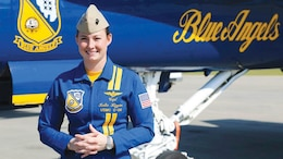 "Marine Capt. Katie Higgins, the first female pilot with the U.S. Navy Flight Demonstration Squadron, or Blue Angels, speaks with media aboard Marine Corps Air Station Beaufort, South Carolina, April 9, 2015. The Severna Park, Maryland native is now the newest pilot of ""Fat Albert,"" a C-130 Hercules flown by the Blue Angels. (U.S. Marine Corps photo by Lance Cpl. Olivia G. Ortiz/Released)"