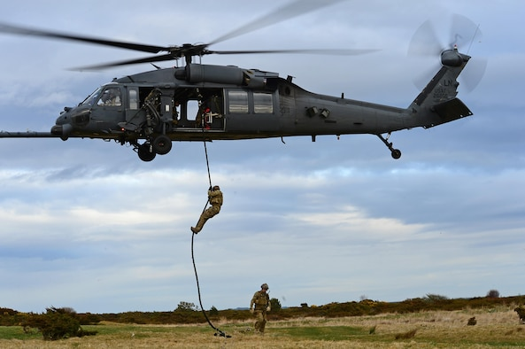 Pararescuemen assigned to Royal Air Force Lakenheath's 57th Rescue Squadron rappel from an HH-60G Pave Hawk in multinational exercise Joint Warrior 15-1 in Scotland, April 21, 2015. About 13,000 personnel from 14 countries participated in the exercise, to strengthen and test their readiness capabilities. (U.S. Air Force photo/Senior Airman Erin O'Shea)