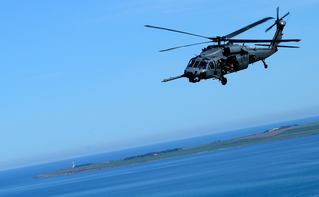 An HH-60G Pave Hawk assigned to Royal Air Force Lakenheath's 56th Rescue Squadron, flies over Scotland during exercise Joint Warrior 15-1, April 22, 2015. The training challenged aircrew, while preparing them for expeditionary operations. (U.S. Air Force photo/Senior Airman Erin O'Shea)