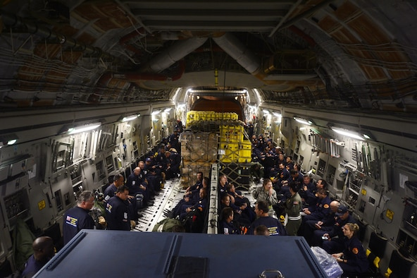 Service members load relief supplies for victims of the Nepal earthquake into a C-17 Globemaster III from Joint Base Charleston, S.C., at March Air Force Base, Calif., April 26, 2015. The U.S. Agency of International Development's relief cargo included eight pallets, 59 Los Angeles County Fire Department personnel and five search and rescue dogs. (U.S. Air Force photo/Airman 1st Class Taylor Queen)
