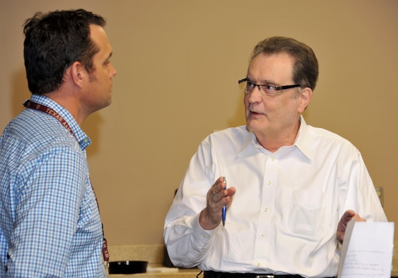 Chuck Beach, the Resource Efficiency Manager (REM) at Fort Knox, Kentucky, talks about third-party financing options with Rob Mackey, Huntsville Center's Energy Savings Performance Contracting (ESPC) program manager April 15 during the Army's first REM Workshop.