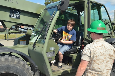 "On 23 April 2015 the Marines of 8th Communication Battalion conducted a family friendly ""Bring your child to work day"" event. The families enjoyed seeing some of the tools and equipment utilized by their Marines as well as getting a little hands on with some heavy equipment and some weapons systems. All in all it was a great time for the families and their Marines."