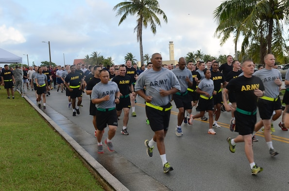 Participants begin the Sexual Assault Awareness Month 5K at Andersen Air Force Base, Guam, April 27, 2015. The Sexual Assault Awareness Month 5K was held by the 94th Army Air and Missile Defense Command Task Force Talon. The 5K brought the sister services together to bring awareness to sexual assault prevention. (U.S. Air Force photo by Airman 1st Class Alexa Ann Henderson/Released)