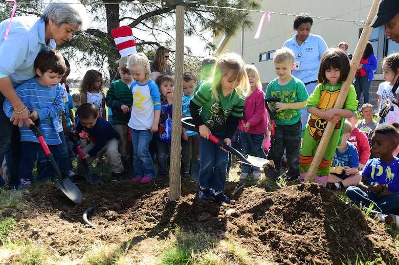 """Children from the Crested Butte Child Development Center participate in a ceremonially planting of a tree to symbolize Buckley Air Force Base achieving Tree City USA status April 23 at Buckley AFB, Colo. Buckley received the Tree City USA award for meeting four core standards of sound urban forestry management: maintaining a tree board or department, having a community tree ordinance, spending at least $2 per capita on urban forestry and celebrating Arbor Day. """"It is our opportunity to show the community that we care for their community, as our operations affect their environment,"""" said Celiann Gonzalez Jurabe, 460th Civil Engineer Squadron environmental element chief. (Air Force photo by Airman 1st Class Luke W. Nowakowski/Released)"""