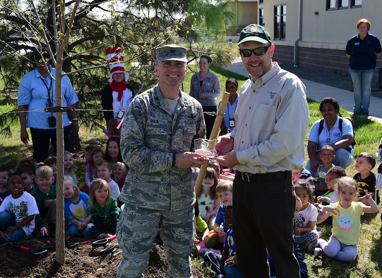 Col. Darren Buck, 460th Space Wing vice commander, was presented the Tree City USA award from Keith Wood, Colorado State Forester and member of the Arbor Day Foundation April 23 on Buckley AFB, Colo. Communities achieve Tree City USA status by meeting four core standards of sound urban forestry management: maintaining a tree board or department, having a community tree ordinance, spending at least $2 per capita on urban forestry and celebrating Arbor Day. Trees in Buckley increase property values, enhance the economic vitality of business areas and beautify our community. (Air Force photo by Airman 1st Class Luke W. Nowakowski/Released)