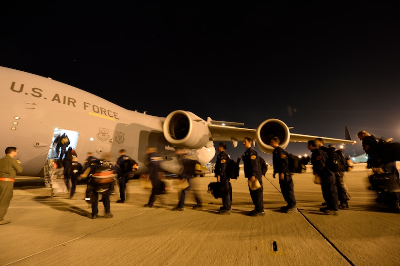 U.S. Air Force personnel load relief supplies for victims of the Nepal earthquake into a USAF C-17 Globemaster III from Joint Base Charleston, S.C., at March Air Force Base, Calif., April 26, 2015. The U.S. Agency of International Development relief cargo included eight pallets, 59 Los Angeles County Fire Department personnel, and five search and rescue dogs. (U.S. Air Force photo by Airman 1st Class Taylor Queen/Released)