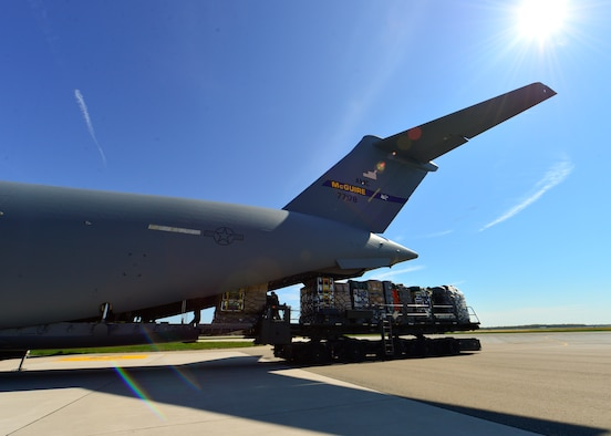 U.S. Air Force Airmen, Dover AFB, Del., load a C-17 Globemaster III with approximately 70,000 pounds of equipment and supplies for the Fairfax County Urban Search and Rescue Team, April 26, 2015, at Dover Air Force Base, Del. The 69-member team is deploying to Nepal to assist with rescue operations after the country was struck by a 7.8-magnitude earthquake. (U.S. Air Force photo/Airman 1st Class William Johnson)