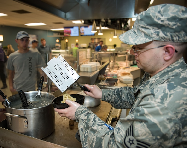 Staff Sgt. Nicholas Patton, 446th Force Support Squadron services craftsman, serves pasta during lunch at the Contrails Dining Facility on Beale Air Force Base, April 23. In addition to his food service training Patton is trained in lodging, fitness, recreation and mortuary affairs. (U.S. Air Force photo by Staff Sgt. Brenda Davis)