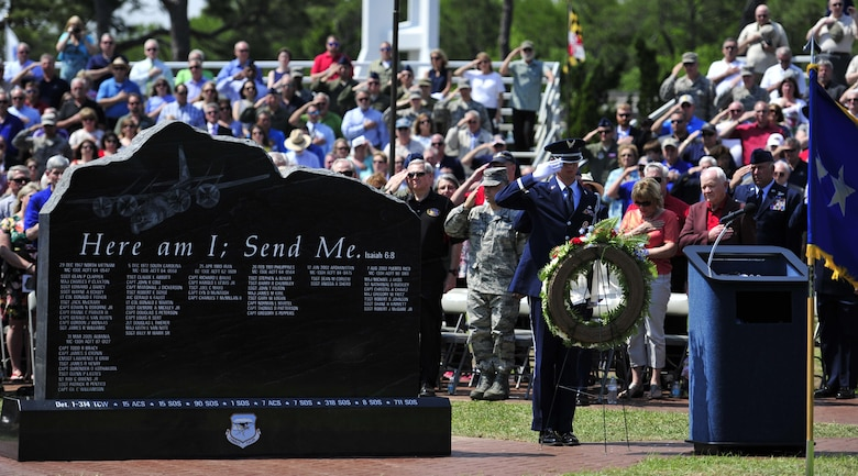 The audience pays their respect after an honor guardsman presents a wreath during the Combat Talon Memorial Dedication ceremony on Hurlburt Field, Fla., April 24, 2015. (U.S. Air Force photo/Staff Sgt. Melanie Holochwost)